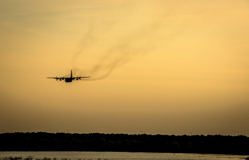 An Air Force Reserve aircrew flying a C-130 Hercules assigned to the 910th Airlift Wing, Youngstown Air Reserve Station, Ohio, performs aerial spraying of mosquitos June 15, 2013, over Joint Base Charleston – Weapons Station, S.C. The insecticide the unit uses is mixed with water to dilute the product. (U.S. Air Force photo/Senior Airman Dennis Sloan)