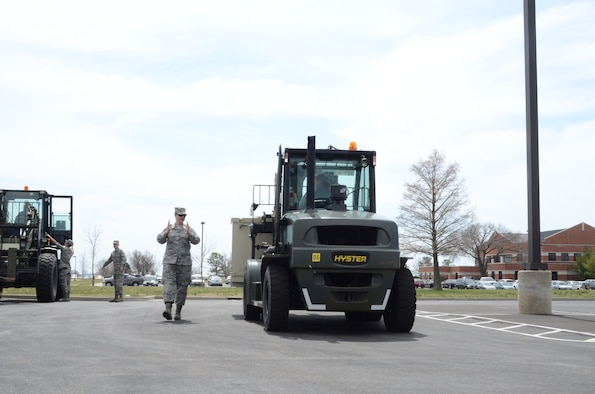 Tech Sgt. Nichole Peterson, a Services Technician with the 126th Force Support Squadron, directs forklift training during the 126 FSS field training exercise at Scott AFB, Ill., April 6, 2013. The Illinois Air National Guard unit conducted training with both active duty and other National Guard units during the April unit training assembly. (National Guard photo by Airman 1st Class Elise Stout)
