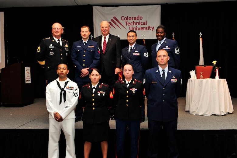 Winners from the 37th Annual Armed Forces Recognition Luncheon gather for a group photo June 14, 2013, at the Renaissance Hotel in Denver. The Aurora Chamber of Commerce and Defense Council recognized 11 military members from all branches and components for their achievements on and off duty. (U.S. Air Force photo by Airman 1st Class Darryl Bolden Jr./Released)
