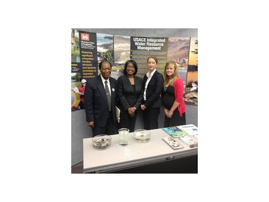 Alcorn State University's Earth Day Celebration Program Chairman Dr. Alex Ancholonu, left, thanked the Environmental Laboratory's exhibit and speaker participants at the April 22 symposium and exhibition.