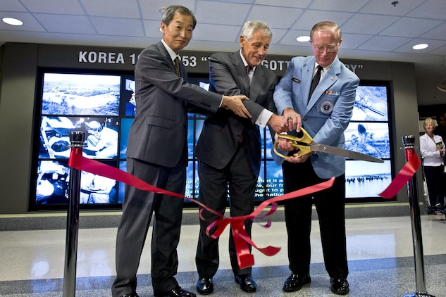 Secretary of Defense Chuck Hagel, center, Korean Ambassador to the United States Ahn Ho-young, left, and National Director of the Korean War Veterans Association Lew Ewing, cut the ribbon to dedicate a new instillation in the Pentagon to commemorate the Korean War, June 18, 2013. Hagel thanked Korean War veterans attending for their service and said that the war and their service will never be forgotten.