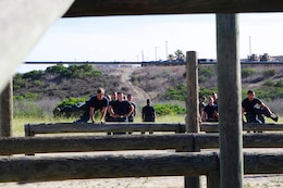 Midshipmen race through the obstacle course during Marine Week of Career Orientation and Training for Midshipmen-West 2013 here June 12. Future officers from across the U.S. participated in the four-weeks of training designed to introduce them to career opportunities.