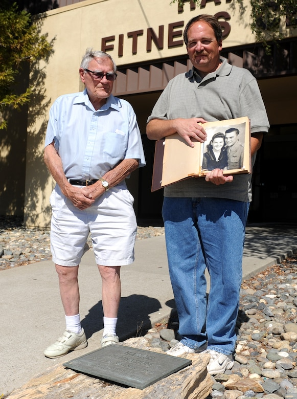 Larry Harris (left), brother of 2nd Lt. Everett Harris, and Larry Harris Jr., nephew of Everett, visit a plaque dedicated to Everett at Beale Air Force Base, Calif., June 8, 2013. On Nov. 14, 1966, the Harris Fitness Center was named after Everett a P-38 Lightning reconnaissance pilot who was killed in action during World War II. (U.S. Air Force photo by Airman 1st Class Bobby Cummings/Released)