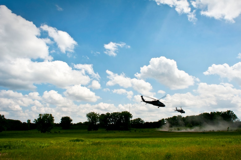 Two Black Hawk helicopters from the Minnesota Army National Guard make their final departure in Arden Hills, Minn., Jun. 18, 2013. 