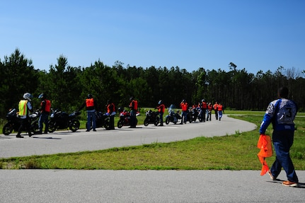 Motorcyclists prepare to train during the Joint Base Charleston Street Riding Skills Mentorship Program's motorcycle training event June 14, 2013, at JB Charleston - Weapons Station, S.C. The program is structured to provide beginner, intermediate and advanced motorcycle riders challenging riding exercises commensurate with their skill level. This three-level training plan provides emergency and lifesaving exercises to practice at normal street speeds, giving motorcycle riders the experience to perform these maneuvers in normal traffic conditions when necessary. (U.S. Air Force photo/ Airman 1st Class Chacarra Neal)