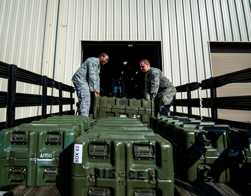 Senior Airman Robert Reynolds, 628th Logistics Readiness Squadron Individual Protective Equipment technician, moves four cases of M-16 rifles from the LRS vault to a truck to be transported to Airmen at the 628th Security Forces Squadron Combat Arms Training for an inspection June 13, 2013, at Joint Base Charleston – Air Base, S.C. The CATAM instructors are required to inspect all of the M-16s held in the vault once every year. (U.S. Air Force photo/ Senior Airman Dennis Sloan)