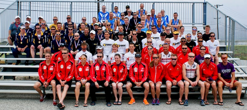 """Competitors from the U.S. Air Force, Army, Marines, Navy, and athletes from the Canadian military forces sit together after the Armed Forces Triathlon, June 1, 2013, at Naval Base Ventura County, Point Mugu, Calif. The triathlon was an """"Olympic"""" distance triathlon, consisting of nearly a mile swim, 24.8-mile bicycle ride and 6.2 mile run. (Courtesy photo/Released)"""