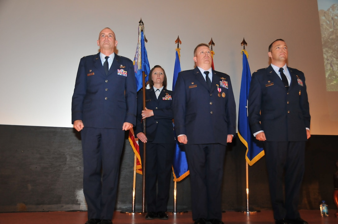 Col. Andrew McIntyre, 19th Operations Group commander, Lt. Col. Rodney Simpson, outgoing 30th Airlift Squadron commander and Lt. Col. Blair Kaiser, incoming 30 AS commander, prepare for a change of command at the F.E. Warren Air Force Base theatre, Cheyenne, Wyo., June 1, 2013. The 30th AS is an active associate flying squadron that partners with the 153rd Airlift Wing, Wyoming Air National Guard. (Air National Guard photo by Staff Sgt. John Galvin)