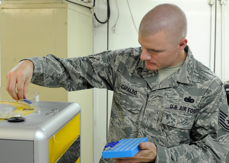 Tech. Sgt. Thomas Capaldo inserts test tubes into a device that conducts a sulfur analysis on fuels in the 379th Expeditionary Logistics Readiness Squadron Air Force Petroleum Laboratory in Southwest Asia, June 12, 2013. This test is one of 15 conducted to ensure the quality of fuels used on aircraft throughout the area of responsibility. Capaldo is the 379th ELRS AFPA NCO in charge of fuels deployed from Dyess Air Force Base, Texas. (U.S. Air Force photo/Senior Airman Bahja J. Jones)