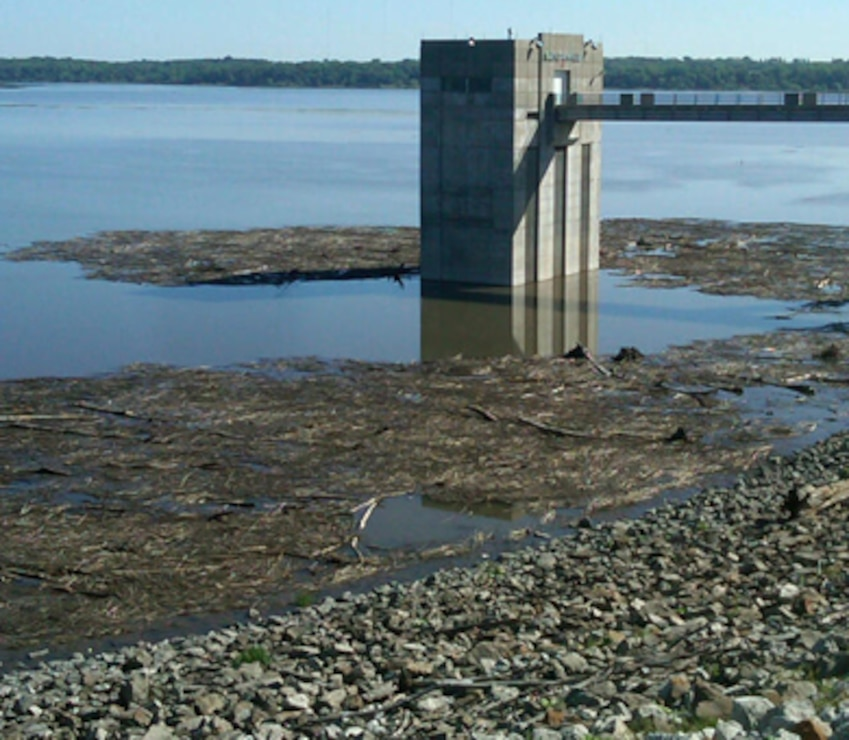 Debris accumulates around Saylorville Lake's control tower and along the dam June 4, 2013.