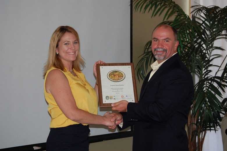 Susan Waichulis (left), project manager with the Fort Myers regulatory section, was recognized by Larry Williams, U.S. Fish and Wildlife Service, for her role in performing the jurisdictional determination needed to move the project forward.