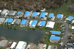 """""""Blue roofs"""" dot the landscape in this aerial photo taken near Port Charlotte following Hurricane Charley in 2004.  Jacksonville District maintains Temporary Roofing and Temporary Housing Response Teams to assist local officials with unmet needs following a disaster."""
