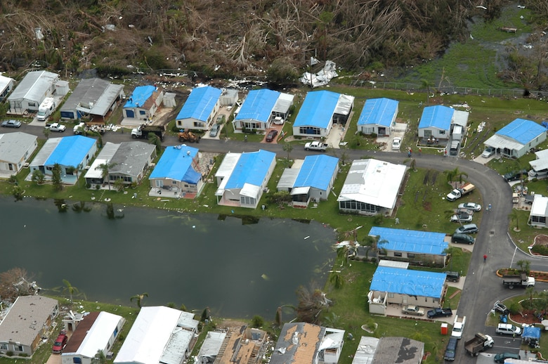 """Blue roofs"" dot the landscape in this aerial photo taken near Port Charlotte following Hurricane Charley in 2004.  Jacksonville District maintains Temporary Roofing and Temporary Housing Response Teams to assist local officials with unmet needs following a disaster."