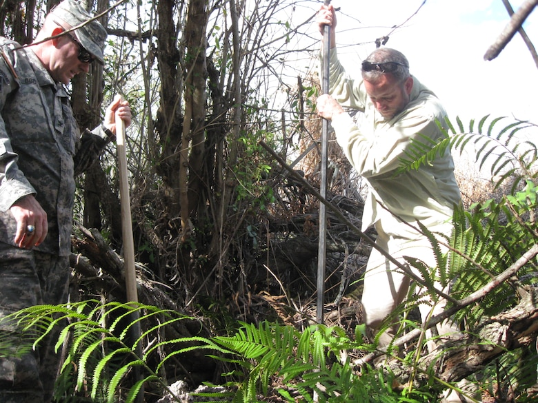 Col. Alan Dodd (left), district commander and Eric Bush (right), chief, Planning and Policy Division, conduct archaeological compliance fieldwork for the Central Everglades Planning Project.