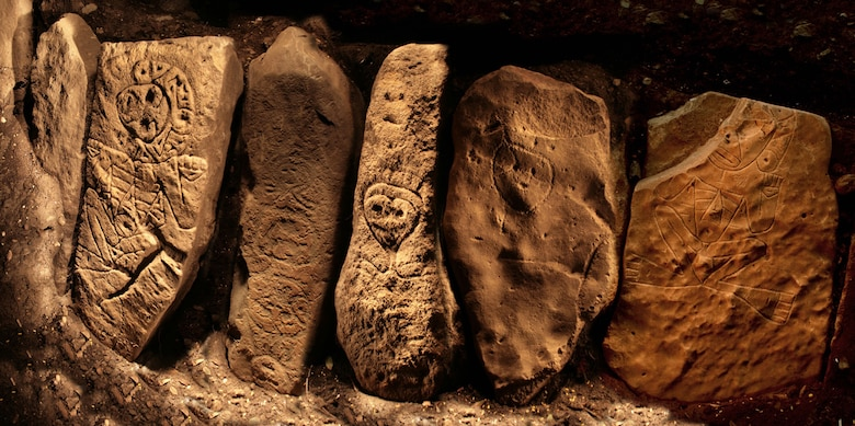 These intricately carved ancient petroglyphs are part of a 60-foot row of well-carved stones discovered at the archaeological site near the Portugues Dam construction site in Ponce, Puerto Rico.