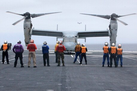 An MV-22B Osprey from Marine Medium Tiltrotor Squadron 161 (VMM-161) lands onboard the JS Hyuga (DDG-181), during Dawn Blitz 2013 for the first time in history off the coast of Naval Base Coronado, June 14. Exercise Dawn Blitz 2013 is a multinational amphibious exercise off the Southern California coast that refocuses Navy, Marine Corps and coalition forces in their ability to conduct complex amphibious operations essential for global crisis response across the range of military operations.
