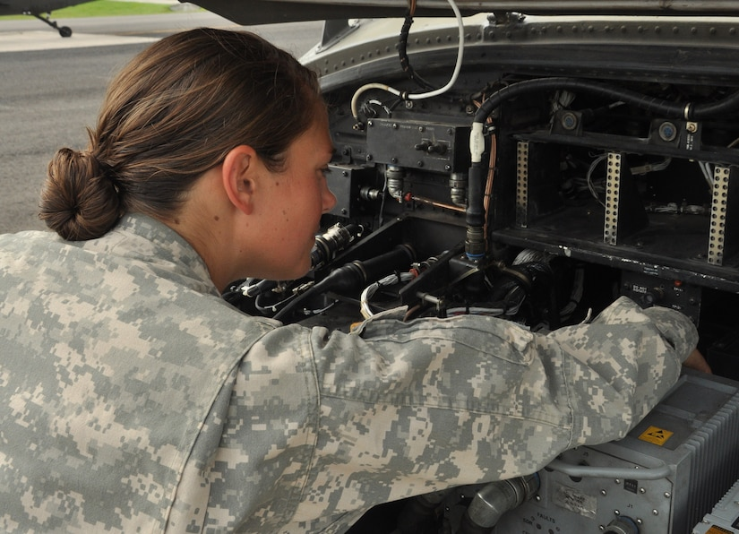 U.S. Army 1st Lt. Martha Hugo, a 1-228 Aviation Regiment Alpha Company pilot, checks the avionic department of the Utility Helicopter-60 Blackhawk, at Soto Cano Air Base, Honduras, for loose wires and to ensure the security of the electronics June 17, 2013 before flying the aircraft. The 1-228 ARAC provided their junior pilots with a mission scenario and had them create a mission plan from start to finish and then perform the task.