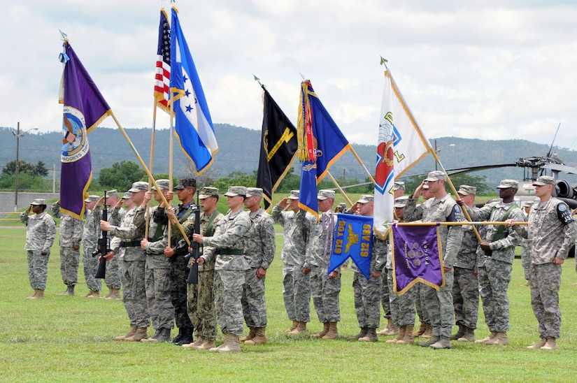During the Joint Task Force-Bravo Change of Command Ceremony, members of the JTF-Bravo Color Guard post the JTF-Bravo colors on the Soto Cano Air Base, Republic of Honduras parade grounds June 20, 2013. The ceremony was held for the out-going JTF-Bravo Commander Col. LeMire and the incoming JTF-Bravo Commander Col. Boccardi.