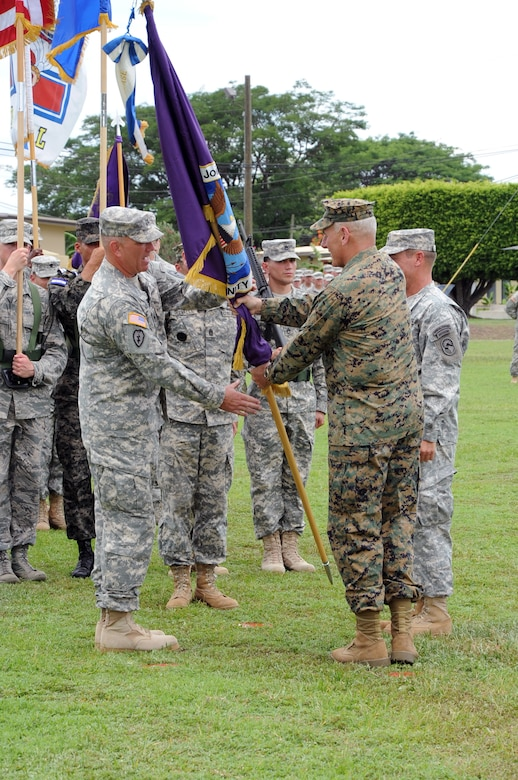 Army Col. Thomas D. Boccardi assumes command of Joint Task Force- Bravo, at Soto Cano Air Base, Republic of Honduras by accepting the guidon from Marine Gen. John F. Kelly, the U.S. Southern Command commander June 20, 2013. Col. Boccardi assumed command from Army Col. Guy A. LeMire. Joint Task Force-Bravo operates on the Honduran military installation, Soto Cano Air Base, in central Honduras and is comprised of more than 600 U.S. military personnel and more than 650 U.S and Honduran civilians. JTF-Bravo works to build partnerships with Honduras and other Central American countries to foster security, stability and prosperity for the Americas.  JTF-Bravo conducts a variety of missions in Central America from supporting U.S. Government operations to counter transnational crime to humanitarian assistance/disaster relief and building partner capacities. The successful completion of these missions allows JTF-Bravo to promote security throughout the region, which is the foundation for stable and productive societies.