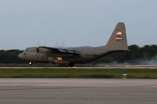 Joint Base Charleston – Air Base, S.C. -- A specially-modified Air Force Reserve C-130 Hercules tactical cargo aircraft, assigned to the 910th Airlift Wing, based at Youngstown Air Reserve Station, Ohio, lands on the runway here, June 15, 2013. The aircraft and crew, part of the 910th's Aerial Spray Unit, just concluded spray operations at the Joint Base's Naval Weapons Station to control the population of the disease-carrying pest insects at the installation. The 910th's 757th Airlift Squadron is home to the Department of Defense's only large-area, fixed-wing aerial spray capability. U.S. Air Force photo by Tech. Sgt. Rick Lisum.