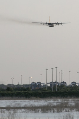 Joint Base Charleston – Weapons Station, S.C. – A specially-modified Air Force Reserve C-130 Hercules tactical cargo aircraft, assigned to the 910th Airlift Wing, based at Youngstown Air Reserve Station, Ohio, disperses a water-diluted EPA-approved insecticide over an area known as the spoils site here, June 15, 2013. The 30-acre 'spoils site' is known to produce approximately 40-million mosquitoes per acre, or 1.2 billion of the pest insects, annually. The 910th's Aerial Spray Unit conducted spraying operations here, June 15, 2013 to control the population of the disease-carrying pest insects at the installation. The 910th sprayed approximately 16,500 acres to provide much sought relief for the base's populace. The 910th's 757th Airlift Squadron is home to the Department of Defense's only large-area, fixed-wing aerial spray capability. U.S. Air Force photo by Tech. Sgt. Rick Lisum.
