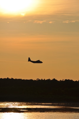 Joint Base Charleston – Weapons Station, S.C. – A specially-modified Air Force Reserve C-130 Hercules tactical cargo aircraft, assigned to the 910th Airlift Wing, based at Youngstown Air Reserve Station, Ohio, disperses a water-diluted EPA-approved insecticide over an area known as the spoils site here, June 15, 2013. The 30-acre spoils site is known to produce approximately 40-million mosquitoes per acre, or 1.2 billion of the pest insects, annually. The 910th's Aerial Spray Unit conducted spraying operations here, June 15, 2013 to control the population of the disease-carrying pest insects at the installation. The 910th's 757th Airlift Squadron is home to the Department of Defense's only large-area, fixed-wing aerial spray capability. U.S. Air Force photo by Master Sgt. Bob Barko Jr.