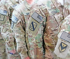 Soldiers with the STB, 1st Sust. Bde. stand at attention prior to the unit's recent redeployment to Fort Riley after its nine-month tour to Afghanistan. The unit deployed in unison with its brigade headquarters.  Photo by: Capt. Kymberly Koenig, 1ST SUST. BDE.