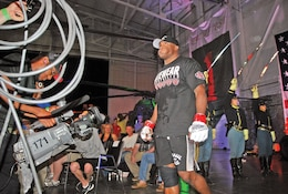 Bobby Lashley, Denver, enters Hangar 727 for his MMA match against Kevin Asplund June 7 at Marshall Army Airfield. Lashley wrestled in the Army for three years and said he was excited to fight for the troops at the event.  Photo by: Julie Fiedler, POST.