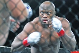 Bobby Lashley faces off against Kevin Asplund in their MMA match at Marshall Army Airfield. Lashley started wrestling while he was a student at Fort Riley Middle School.  Photo by: Julie Fiedler, POST.