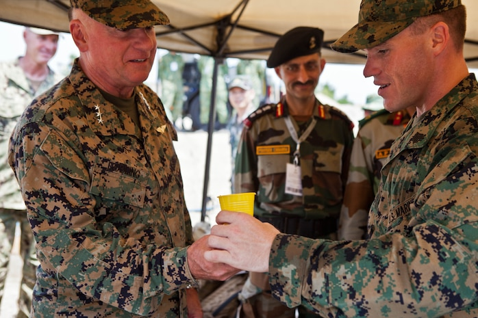 U.S. Marine Sgt. Robert W. Walker, right, provides a sample of purified water from the miniature deployable assistance water purification system to U.S. Marine Lt. Gen. Terry G. Robling at a disaster site in Biang, Brunei Darussalam, June 19 as part of the Association of Southeast Asian Nations Humanitarian Assistance/Disaster Relief and Military Medicine Exercise (AHMX). The disaster site is the location of the field training exercise portion of the multilateral exercise, which provides a platform for regional partner nations to address shared security challenges, strengthen defense cooperation, enhance interoperability and promote stability in the region. Robling is the commanding general of U.S. Marine Corps Forces, Pacific.  Walker is an engineer equipment electrical systems technician with 9th Engineer Support Battalion, 3rd Marine Logistics Group, III Marine Expeditionary Force.