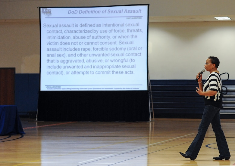 Peggy Moore-McCoy, 460th Space Wing sexual assault response coordinator, briefs members of Team Buckley about the Department of Defense definition of sexual assault June 20, 2013, at the fitness center on Buckley Air Force Base, Colo. Moore-McCoy also informed military members the different type of sexual assault reporting and the privileges that go with them. (U.S. Air Force photo by Staff Sgt. Paul Labbe/Released)