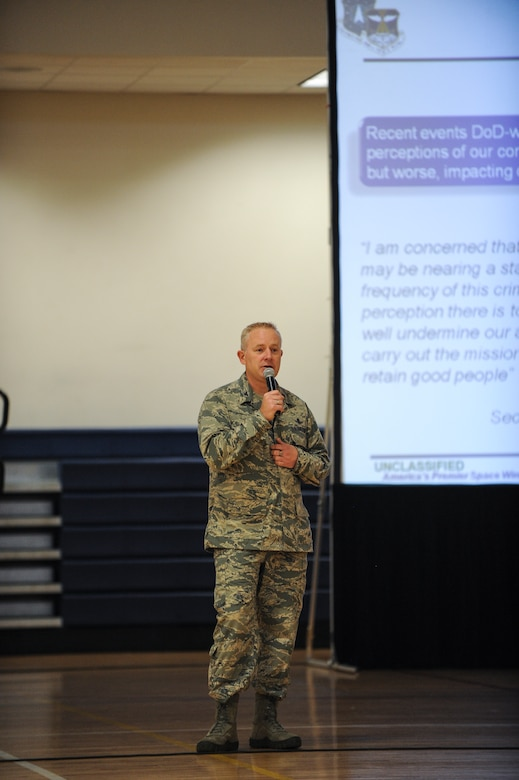 Col. Dan Dant, 460th Space Wing commander, gives opening remarks during a 460th Space Wing commander's call during the Sexual Assault Prevention and Response Stand-down Day June 20, 2013, at the fitness center on Buckley Air Force Base, Colo. The down day gave military members an opportunity to spend the day talking and understanding how sexual assault affects the military. (U.S. Air Force photo by Staff Sgt. Paul Labbe/Released)
