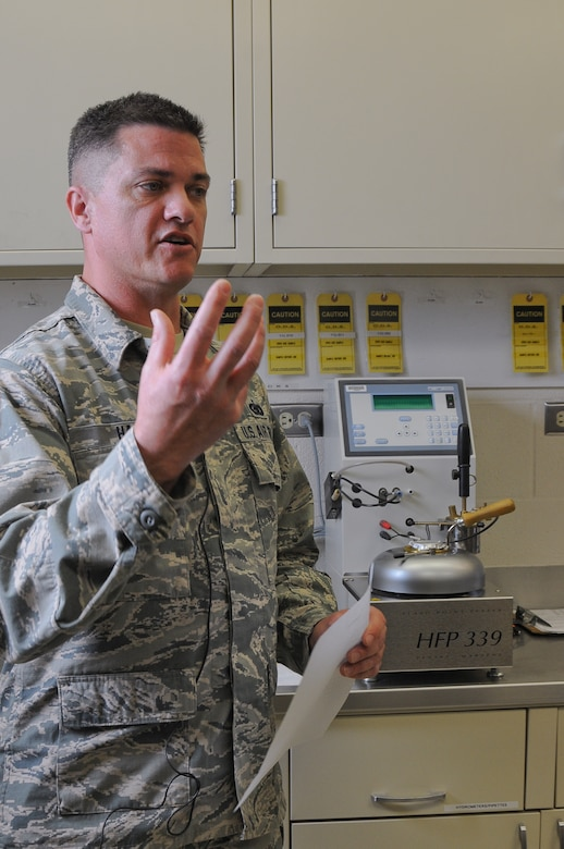 Tech. Sgt. Brian Hain, Fuels Technician, thoroughly describes the JP-8 jet fuel testing and filtration process all the way from the pipeline source to fueling the jets on the flight line at the 124th Fighter Wing Logistics Readiness Squadron open house at Gowen Field July 13. The routine testing saved equipment and possibly lives in 2009 when fuel contaminants were discovered and flying operations were halted until the source was identified and contaminants were cleared. (Air National Guard Photo by Tech. Sgt. Sarah Pokorney)