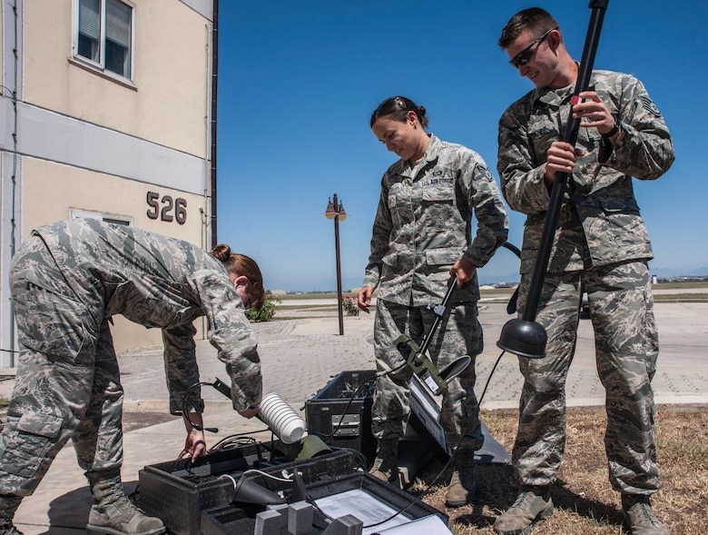 Staff Sgts. Elizabeth Goodwin, Natasha Smith and Michael Beckner, 39th Operations Squadron weather technicians, assemble a tactical meteorological equipment tower June 21, 2013, at Incirlik Air Base, Turkey. The tower is just one piece of equipment the weather flight uses to track weather patterns. (U.S. Air Force photo by Senior Airman Anthony Sanchelli/Released)