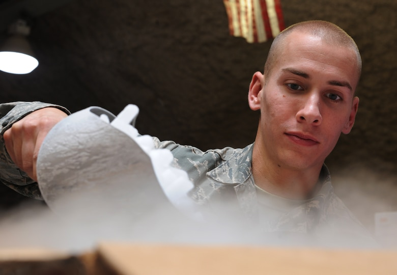 Senior Airman Travis Exner fills a box with dry ice to be shipped to Afghanistan at the379th Air Expeditionary Wing's Blood Transshipment Center in Southwest Asia, June 13, 2013. In addition to blood products, the BTC is the sole provider of dry ice to various locations within the area of responsibility. Exner is a 379th Expeditionary Medical Support Squadron BTC logistics technician deployed from Eglin Air Force Base, Fla. (U.S. Air Force photo/Senior Airman Bahja J. Jones)