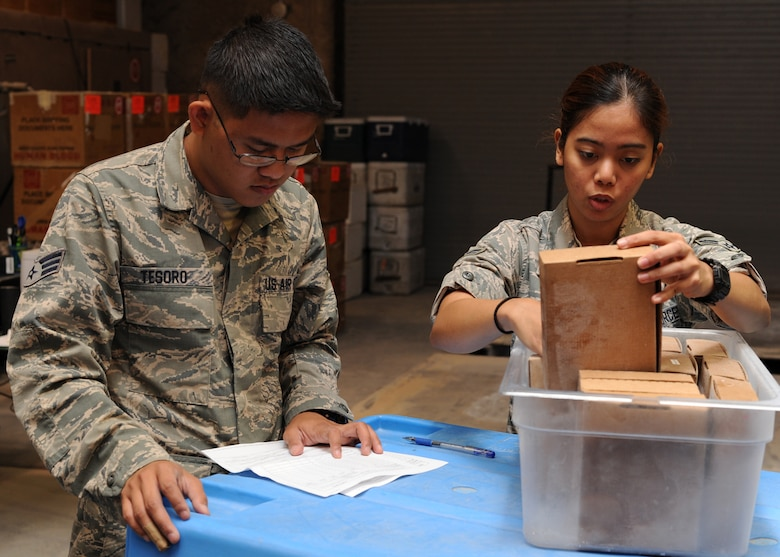 Senior Airman Leonard Tesoro and Airman 1st Class Patricia Ibanez verify the inventory of plasma boxes to be shipped at the379th Air Expeditionary Wing's Blood Transshipment Center in Southwest Asia, June 13, 2013. The plasma boxes were then packed into dry ice and shipped to Afghanistan with other blood products. Tesoro is a 379th Expeditionary Medical Support Squadron BTC lab technician deployed from Eglin Air Force Base, Fla., and Ibanez is a 379th EMDSS BTC administrative technician deployed from Shaw Air Force Base, S.C.  (U.S. Air Force photo/Senior Airman Bahja J. Jones)