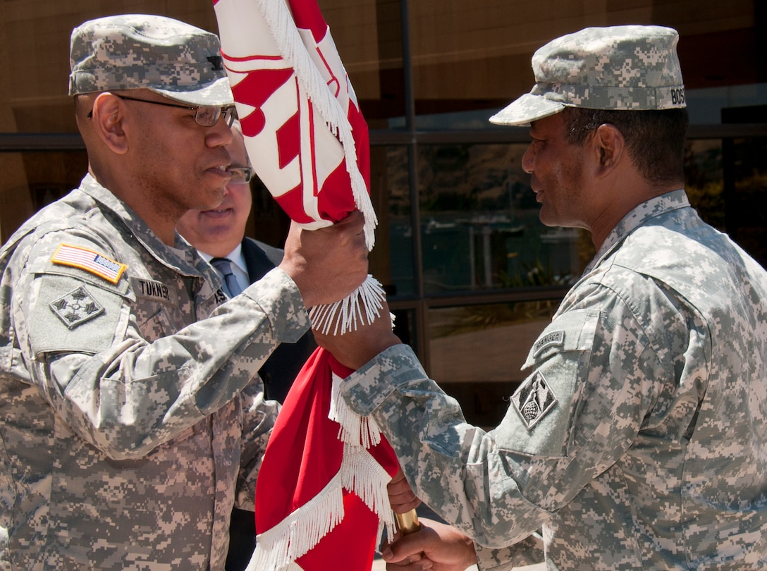 Lt. Gen. Tom Bostick, Chief of the U.S. Army Corps of Engineers, passes the South Pacific Division's Colors to Col. C. David Turner during a Change of Command ceremony Wednesday, June 19, 2013 at the Bay Model in Sausalito, Calif. Col. Turner became the 55th Commander of the South Pacific Division after assuming command from Col. Andrew Nelson, who is resuming duties as the Division Deputy Commander.