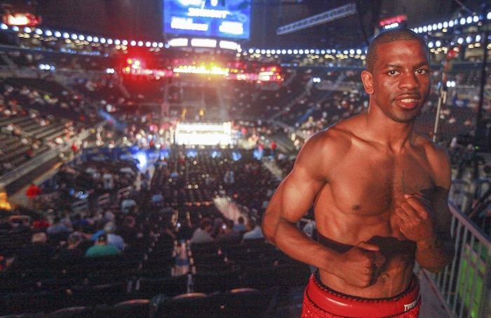 Jamel Herring, a Marine veteran, poses for a photo after his fourth professional win at Barclays Center, Brooklyn, N.Y., June 22.  During Herring's time in the Corps he was a member of the All-Marine Boxing Team, which put him on the path that lead to his qualification to be on the Olympic boxing team.  (U.S. Marine Corps photo by Sgt. Caleb Gomez).