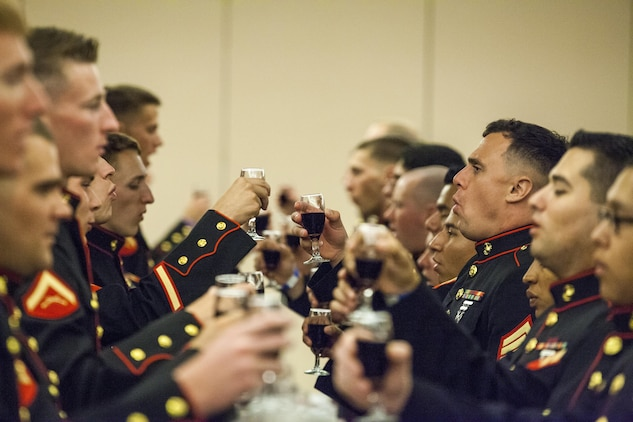 Marines of Marine Air Control Squadron 1 toast the memory of Marines past at the MACS-1 Mess Night on Marine Corps Air Station Yuma, Ariz., at the Sonoran Pueblo, June 7. The Mess Night is a Marine Corps tradition that brings a unit together for an evening of dining and camaraderie.