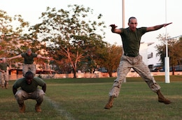 Cpl. Jeffrey Hall (left), food service specialist, and Cpl. Vincent Moore, radio technician, both with Headquarters Platoon, Lima Company, 3rd Battalion, 3rd Marine Regiment, Marine Rotational Force - Darwin, complete star jumps to the next exercise station during a Corporals Course physical training session, here, June 18. The course provides corporals with the education and skills necessary to lead Marines. Two Australian soldiers and a Navy corpsman enrolled in the course to further their Marine Corps knowledge.