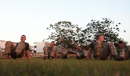 Marines with Lima Company, 3rd Battalion, 3rd Marine Regiment, Marine Rotational Force - Darwin, and Australian soldiers with Charlie Company, 5th Battalion, Royal Australian Regiment, crab walk to the next exercise station during a Corporals Course physical training session, here, June 18. The course provides corporals with the education and skills necessary to lead Marines. Two Australian soldiers and a Navy corpsman enrolled in the course to further their Marine Corps knowledge.