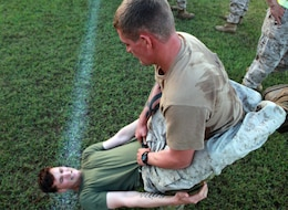 Australian Army Pvt. David Druely, rifleman, Charlie Company, 5th Battalion, Royal Australian Regiment, holds Cpl. Richard Kripps, team leader, 1st Platoon, Lima Company, 3rd Battalion, 3rd Marine Regiment, Marine Rotational Force - Darwin, as he conducts hanging-guard sit ups during a Corporals Course physical training session, here, June 18. The course provides corporals with the education and skills necessary to lead Marines. Two Australian soldiers and a Navy corpsman enrolled in the course to further their Marine Corps knowledge.