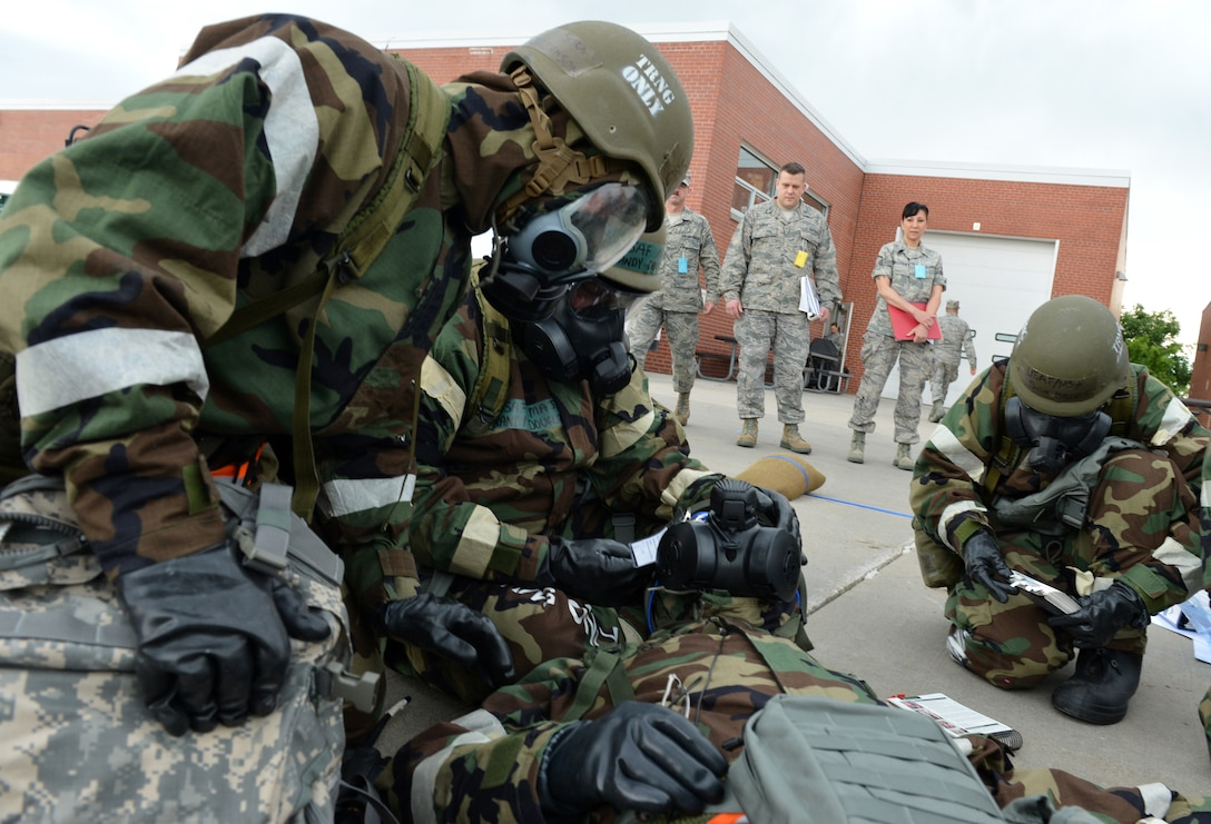 Members of the Nebraska Air National Guard's 155th Air Refueling Wing participate in an Ability to Survive and Operate exercise at the Nebraska National Guard air base in Lincoln, Neb., June 11, 2013. The 155th ARW participated in the ATSO to evaluate and improve their capabilities and skills in a wartime scenario. (U.S. Air National Guard photo by Senior Airman Mary Thach/Released)