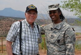 ABIQUIU LAKE, N.M., -- District Commander Lt. Col Gant shares a moment with former Abiquiu Lake Operations Manager Jimmy Hurt after presenting him with an Albuquerque district coin for all of his dedication and hard work, June 13, 2013.