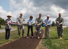 (l to r) Raystown Ranger Tara Whitsel holds the ribbon as Maj. Gen. Michael J. Walsh, Corps Deputy Commander for Civil Works and Emergency Operations; Ms. Jo-Ellen Darcy, Assistant Secretary of the Army for Civil Works; Brig. Gen. Kent Savre, North Atlantic Division commander; Dan Hawbaker, President and CEO of Glenn O. Hawbaker Inc. and Lt. Col. Brad Endres, District Deputy Commander cut a ribbon officially opening the Greenside Pathway at Raystown Lake, June 20.