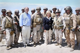 Diane Black and Tom Reed, center, paused for a photo with Marines from I Marine Expeditionary Force participating in a training exercise during a visit to Camp Pendleton where they learned about the base, its functions and daily operations June 23. Black is a congresswoman for the sixth district of Tennessee and Reed is a congressman for the 23rd district of New York.