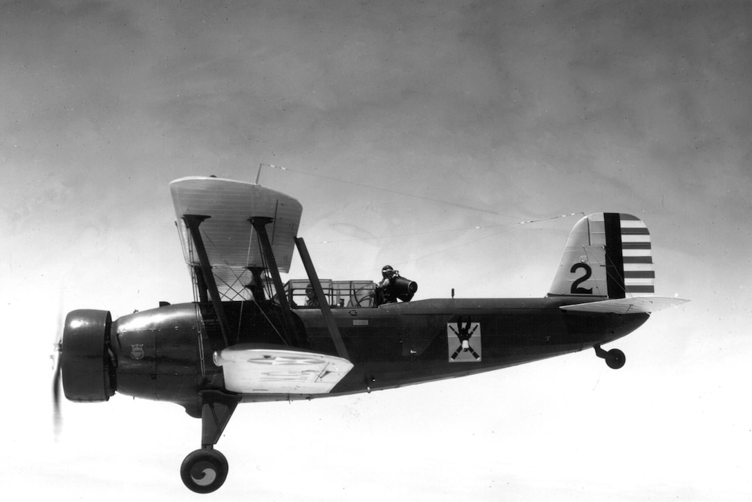 Members of the 110th Observation Squadron, Missouri National Guard, fly a Douglas O-38E observation plan with pilot and photographer onboard, circa 1936.  The photographer is using a K-17 Observation camera.  (131st Bomb Wing file photo/RELEASED)