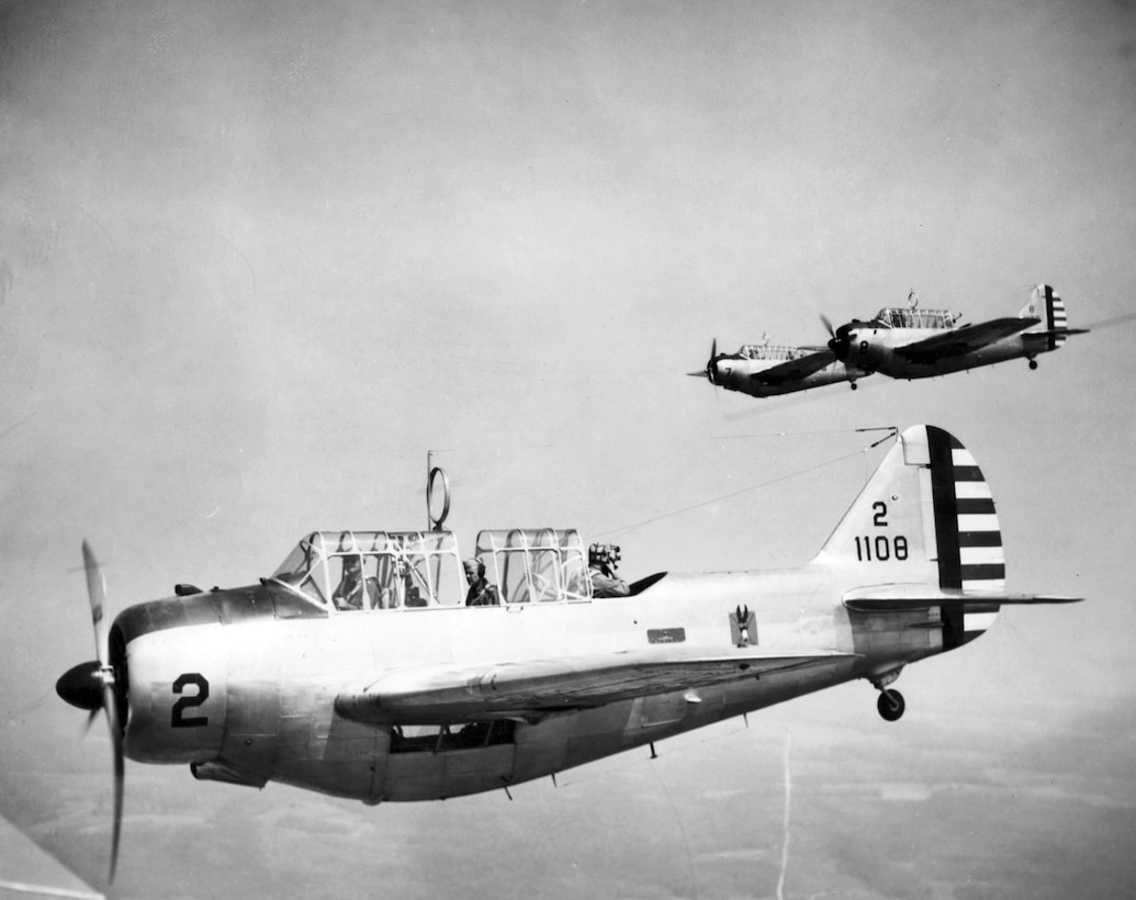 Members of the 110th Observation Squadron, Missouri National Guard, fly a North American O-47A observation plane with pilot, navigator, and photographer onboard, circa 1938.  (131st Bomb Wing file photo/RELEASED)