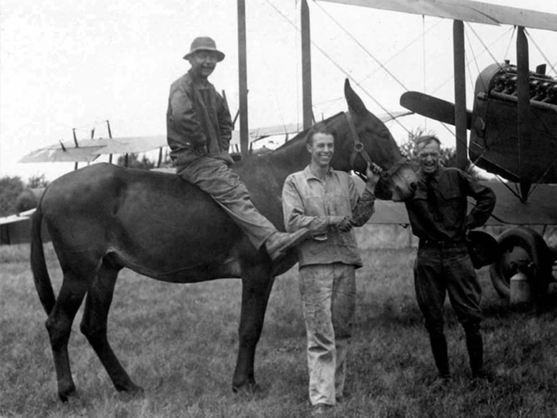 Unidentified members of the 110th Observation Squadron pose with a Missouri Mule at Robertson Field, Saint Louis, MO, 1925. The Missouri Mule has long been identified with the 110th Bomb Squadron and 131st Bomb Wing as the mascot of the unit and appears on patches and aircraft.  (131st Bomb Wing file photo/RELEASED)