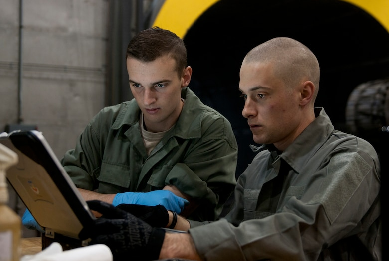 U.S. Air Force Staff Sgt. James Root, 366th Component Maintenance Squadron aerospace propulsion journeyman, and Airman 1st Class Steven Pritchard, 366th CMS aerospace propulsion apprentice, look at computer codes from an engine test run, May 5, 2013, at Mountain Home Air Force Base, Idaho. Similar to a mechanic checking a car engine, a jet engine can be hooked into a computer showing codes for errors and malfunctions. (U.S. Air Force photo by Senior Airman Heather Hayward/Released)